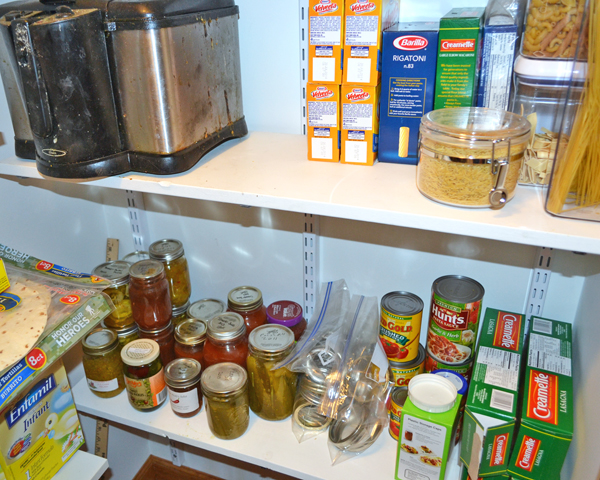 organized pantry pasta and canned goods