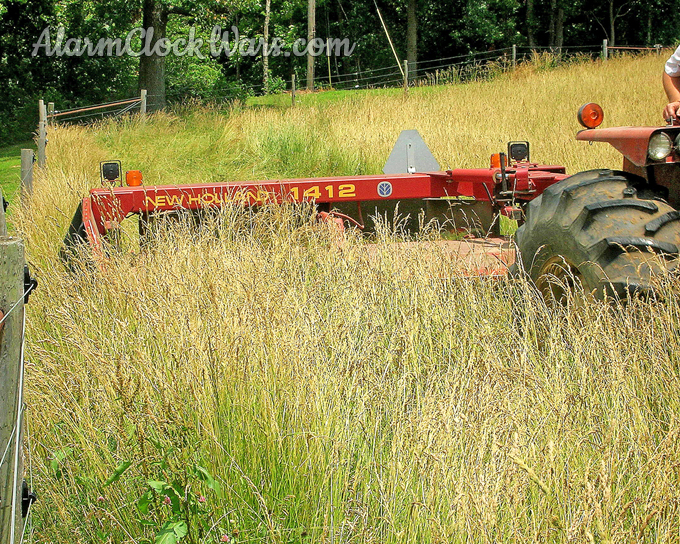 The mower-conditioner cutting hay.