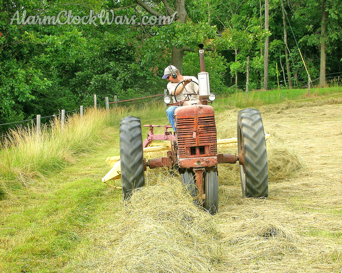Once hay is dry enough to be baled, it is raked into large piles called windrows.
