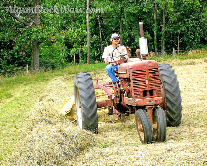 Hay is raked into windrows around and around the hayfield so the baler can scoop the hay up in the next step.
