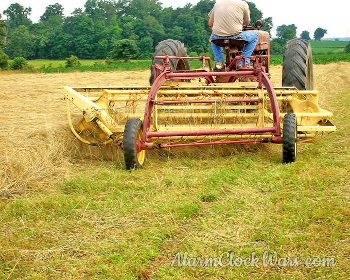 A hay rake sweeps loose hay up into large piles called windrows.