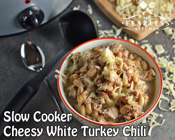 ... Slow Cooker Cheesy White Turkey Chili cooks all day while you relax